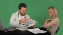Stock Video Footage of Doctor patient history database of young woman on a Green Screen, Chroma Key