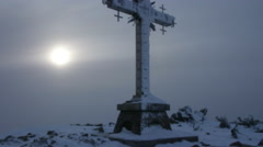 Cross at Mustag mountain top in winter day, Russia, Siberia Stock Footage
