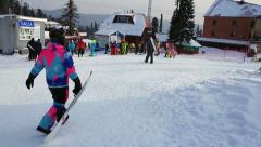 Skiers and snowboarders in the mountains at the ski resort Stock Footage