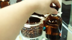 Small bottles with perfume and coffee on a show-window Stock Footage