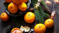 Plate with orange mandarins, Christmas or New Year concept, toned Stock Footage