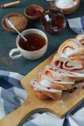 Homemade bun with a cup of tea Stock Photos