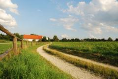 Landscape in Bavaria with a farm and a paddock Stock Photos