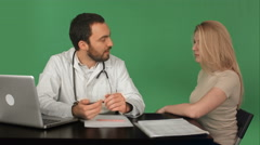 Doctor with patient measuring pulse in a hospital on a Green Screen, Chroma Key Stock Footage
