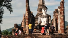 People visit Wat Mahathat temple in Sukhothai, Thailand. Stock Footage