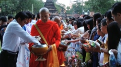 People bring offerings to a Buddhist monk in Sukhothai, Thailand. - stock footage