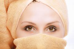 Woman, with towel wound round head Stock Photos