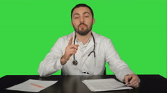 Doctor looking at the camera with an intent expression on a Green Screen, Chroma Stock Footage