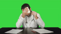 Aggressive disappointed doctor at a table on a Green Screen, Chroma Key - stock footage