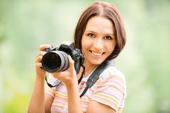 Beautiful girl with camera - stock photo