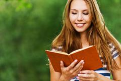 Woman with a book, read Stock Photos