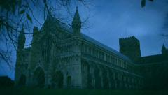 St Albans Abbey with added rain, lightning and falling leaves at night Stock Footage