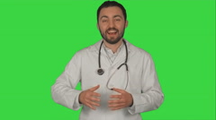 Stock Video Footage of Doctor with good news looking on camera on a Green Screen, Chroma Key