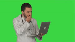 Doctor Having Video Conference on laptop With Patient on a Green Screen, Chroma - stock footage