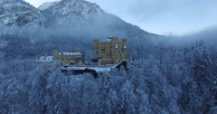 Aerial view of Hohenschwangau Castle at sunrise in winter landscape Stock Footage