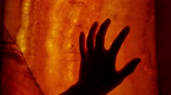 Female hand slipping on red glass horror scene Stock Footage