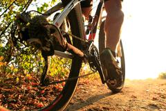 Detail of cyclist man feet riding mountain bike on outdoor Stock Photos