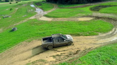 Big grey truck is driving on a dirt track in the nature Stock Footage