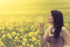 Beautiful woman blowing a single soap bubble in summer nature Stock Photos