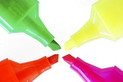 Four fluorescent highlighters with different colours Stock Photos