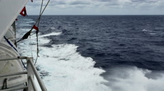 Ocean ship's wake with foam and spray looking aft in choppy seas-sound Stock Footage