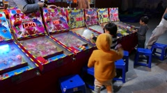 Classic ball gaming machines in row, children play arcade machine Stock Footage