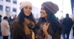 Two stylish young women in winter fashion Stock Footage
