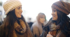 Two young woman enjoying a winter night out Stock Footage