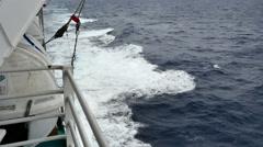 Stock Video Footage of Ocean ship's wake foam and spray looking aft choppy seas