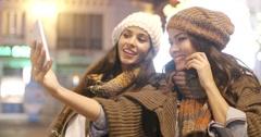 Two vivacious women taking a selfie Stock Footage