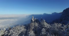 Aerial view of Neuschwanstein Castle at sunrise in winter landscape Stock Footage