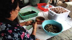 Women pack traditional Thai snack  Miang Chomphon in Tak, Thailand. -1 Stock Footage