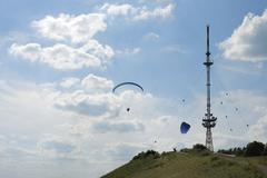 Paragliding at a telecommunication tower Stock Photos