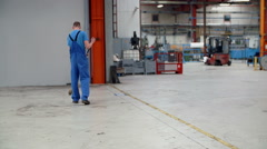 Sweeping the floor in the factory Stock Footage