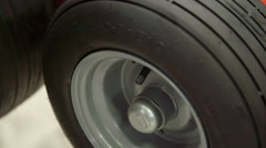 Checking if the rubber wheel needs more air Stock Footage