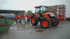 Washing the machinery outside in front of the factory Stock Footage