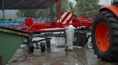 Washing the machinery and the tractor Stock Footage