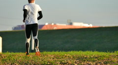 Runner in slow motion, runs along the bank of the Sava River Stock Footage