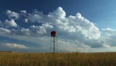 Timelapse Clouds behind Red Water Tower Stock Footage