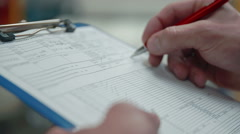 Filling out a form Stock Footage