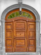 Asolid wooden hand carved timber door Stock Photos