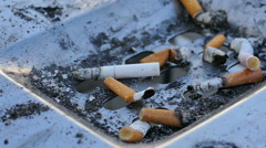 Cigarette butt in an ashtray - stock footage
