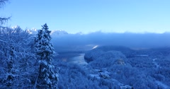 Hohenschwangau Castle and valley at sunrise in winter landscape Stock Footage