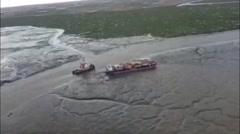 Coast Guard Monitoring Response to Grounded Barge Near Bethel, Alaska Stock Footage