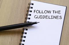 Follow the guidelines write on notebook - stock photo