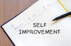 Self improvement write on notebook Stock Photos