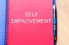 Self improvement write on notebook - stock photo