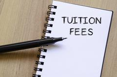 Tuition fees write on notebook - stock photo