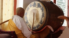 Old Buddhistmeasuredly beats the drum Stock Footage