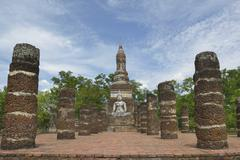 Buddha statue in old temple ruins. Sukhothai historical park Wat Mahathat. Stock Photos